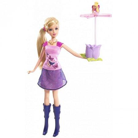 Кукла Барби с Дюймовочкой в руке