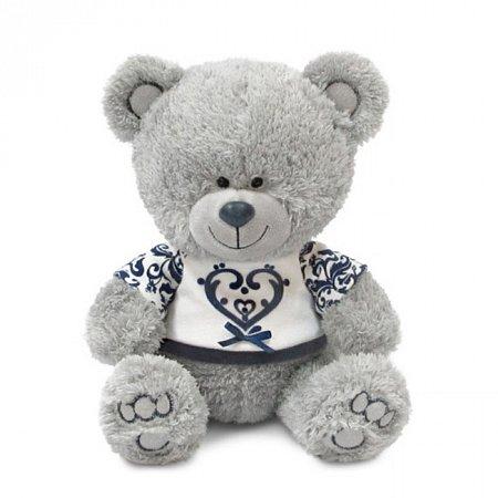 Мягкая игрушка Медвежонок Ники в футболке с синим орнаментом (муз 21,5 см), Lava, LA8786J
